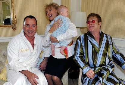 Elton John's Looks On Proudly As Barbara Walters Holds His Son Zachary