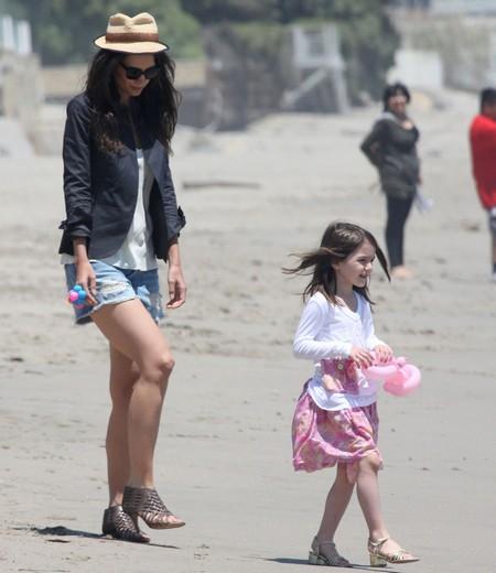 Suri Cruise & Katie Holmes Wear High Heels On The Beach In The Sand