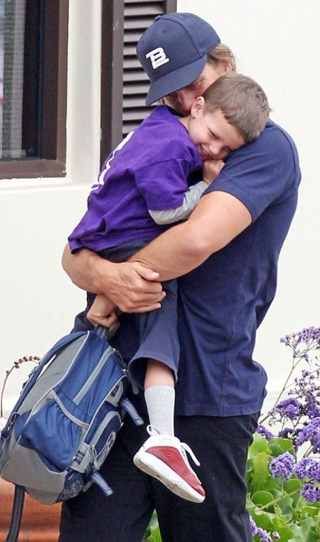 Tom Brady snuggling his eldest son John Edward while out in Malibu