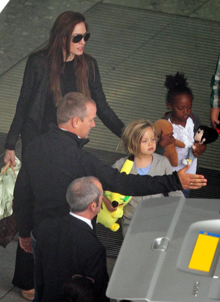 Angelina Jolie and Her Girls Touch Down
