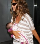 Denise Richards, is seen at JFK Airport with her newly adopted baby Eloise Joni accompanied by her two daughters Sam and Lola Sheen