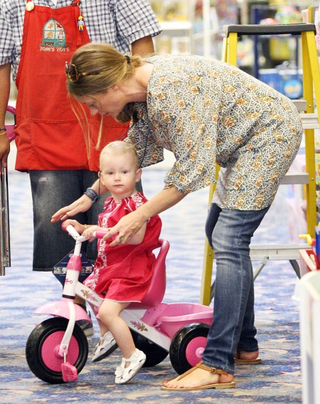 Pregnant Rebecca Gayheart takes baby Billie shopping for toys in Los Angeles, CA on July 29, 2011.