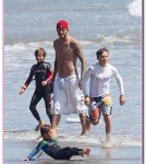 WIPEOUT! David Beckham's son Cruz takes a spill as he tries his hand at Skimboarding with his dad and brothers in Malibu
