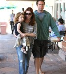 Alyson Hannigan grocery shops with her family at Ralphs in Malibu, Ca on August 13, 2011.