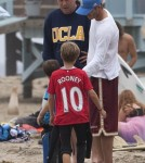 David Beckham's Son Rome Wears a Wayne Rooney Jersey