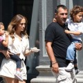 Jennifer Lopez carries her children Max and Emme around the set of her new music