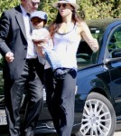 Sandra Bullock steps out of her LA home holding onto her dapper son, Louis Bardo