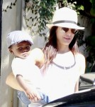 Sandra Bullock steps out of her LA home holding onto her dapper son, Louis Bardo