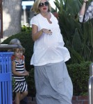 i Spelling and her hubbie Dean McDermott take their kids Liam and Stella to a playground in Cross Creek, Malibu