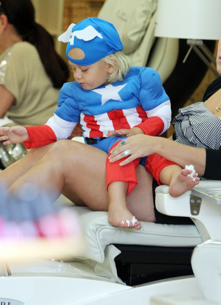 Zuma Rossdale in a Captain America costume as he gets his toes done