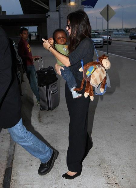 Sandra Bullock with baby Louis at Austin Texas Airport