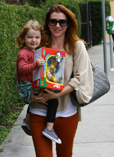 Alyson Hannigan Picks Up a Toy With Satyana