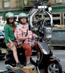 Alicia Silverstone films scenes on a Vespa with her co-stars from 'Gods Behaving Badly.' Silverstone's husband, Christopher Jarecki waits with the couple's son, Bear Blu Jarecki