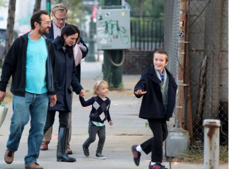 Jennifer Connely and Paul Bettany take a walk with a friend and their three children, Kai, Stellan and Agnes Lark