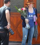 Actress Hilary Duff gets flowers from paparazzo in Los Angles, Ca for her Birthday on September 28, 2011.