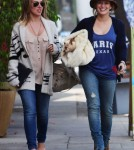 Hilary Duff made her way out of a Vet in Sherman Oaks, California on September 28, 2011 with her sister Haylie after picking up their small dog.