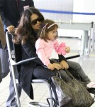Salma Hayek and daughter Valentina are escorted to their departure gate in a wheelchair at LAX