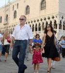 ss Salma Hayek and Francois-Henri Pinault with their daughter Valentina in piazza San Marco, Venice.