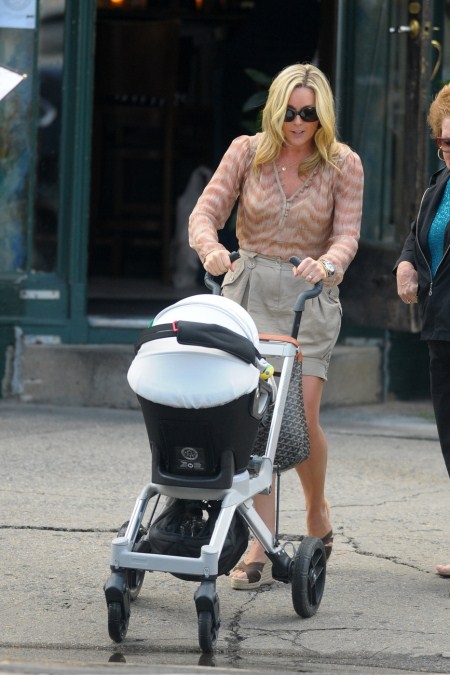 Jane Krakowski pushing around her baby boy Bennet Robert in a stroller around New York.