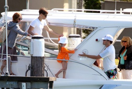 Leonardo DiCaprio, Tobey Maguire and wife Jennifer Meyer, and their daughter Ruby On a Boat