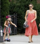 Maggie Gyllenhaal watches as her daughter Ramona rides her scooter around Brooklyn