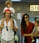 Matthew McConaughey and his wife Camila Alves arrive at LAX with their children Levi and Vida