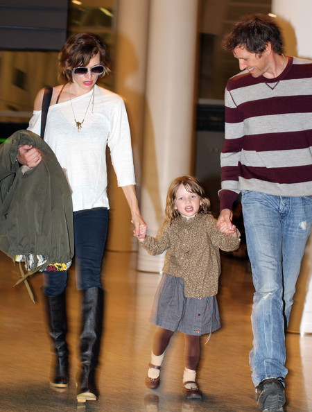 Milla Jovovich, her husband Paul W.S. Anderson and daughter Ever arriving at the airport in Toronto, Canada