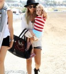 Nicole Richie hits the beach in Malibu, CA on September 3, 2011 with daughter Harlow Madden