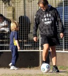Russell Crowe kicks a soccer ball around with youngest son Tennyson