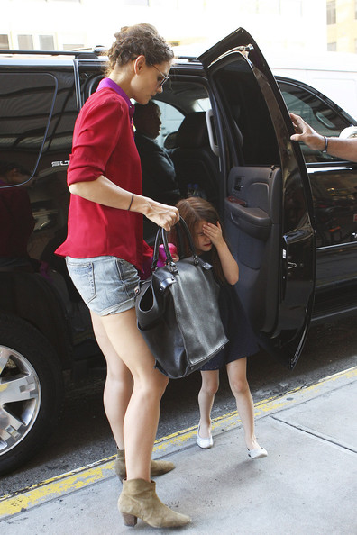 Suri Cruise, age 5, seen wearing a dark shade of lipstick as she and Katie Holmes arrive back at their NYC apartment.