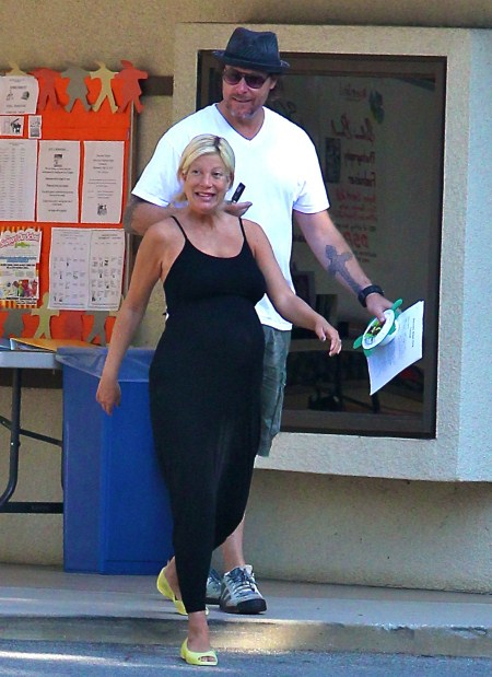 Pregnant Tori Spelling looks about to pop as she goes out with husband Dean McDermott in Los Angeles, CA on September 27, 2011