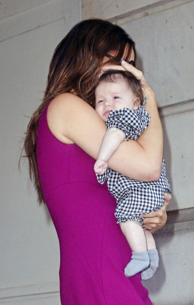 Victoria Beckham holds Harper close as she leaves the Plaza Hotel in New York City after having lunch.