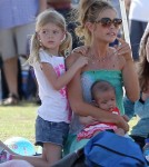 Denise Richards takes her baby daughter Eloise to the park with older daughters Lola and Sam to watch Sam play soccer