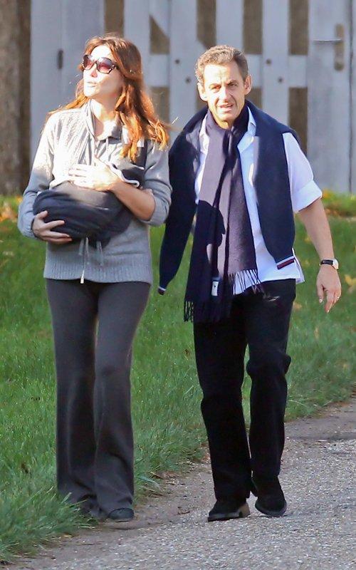 Nicolas and Carla Bruni Sarkozy Take Newborn Daughter For A Walk