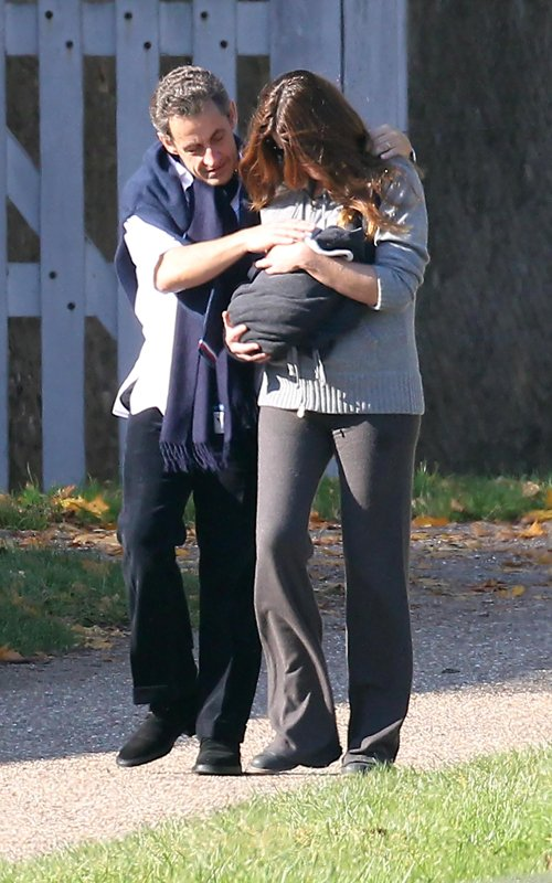 Nicolas and Carla Bruni Sarkozy and their newborn daughter Giulia take a walk in Versailles, France