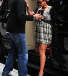 Beyonce shows off her growing belly as she leaves the Gansevoort hotel in NYC.