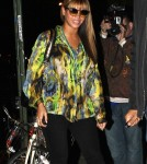 Pregnant singer Beyonce covers her baby bump in a vivid print shirt as she went out to dinner in NYC, NY on October 25, 2011.