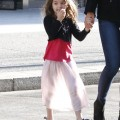 Katie Holmes and daughter Suri Cruise make their way out of their Pittsburgh, Pennsylvania hotel on October 6, 2011.