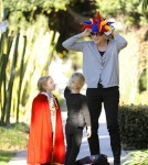 Marcia Cross makes some last minute adjustments to the Halloween costumes of her twin daughters, Eden and Savannah before they go into a party.