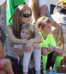 Denise Richards cheers on her daughter Lola during her soccer game while on the sidelines with her other daughter Sam