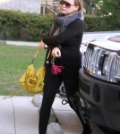 Hilary Duff made her way to a Pilates class in Los Angeles, California on October 26, 2011 wearing an all black tight outfit which showed off her growing baby bump.