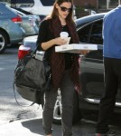 Pregnant actress Jennifer Garner shows off he baby bump while out for Starbucks, Kispy Kreme and a quick visit to the doctor in Los Angeles, California on October 3, 2011.