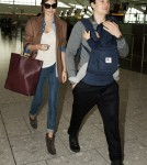 Miranda Kerr and Orlando Bloom with Son Flynn at Heathrow International Airport in London, England (October 12).