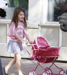 Katie Holmes takes her adorable daughter Suri for a walk as Suri pushes a play stroller for her panda bear stuffed animal in Pittsburgh 10-08-2011