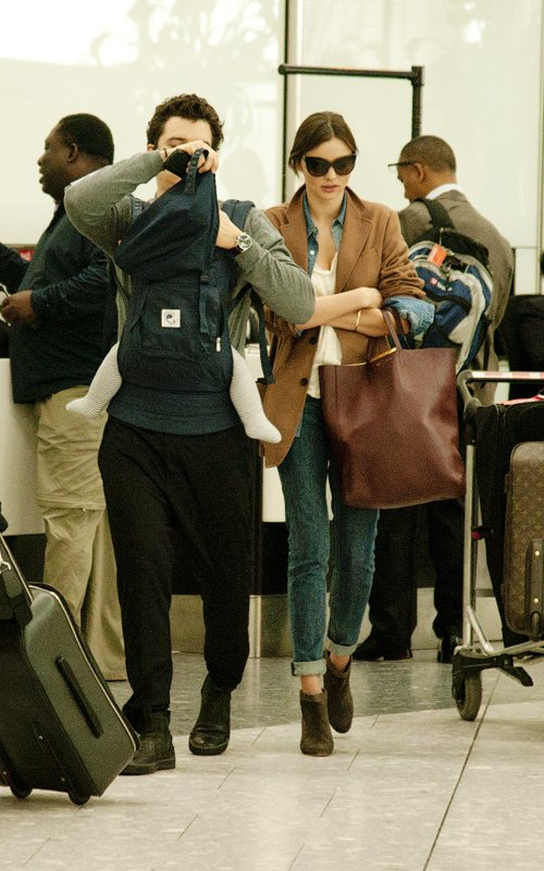 Miranda Kerr and Orlando Bloom with Son Flynn at Heathrow International Airport in London, England (October 12).