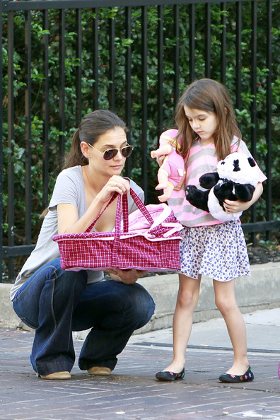 Katie Holmes and Suri Stroll With a Panda Bear and a Doll