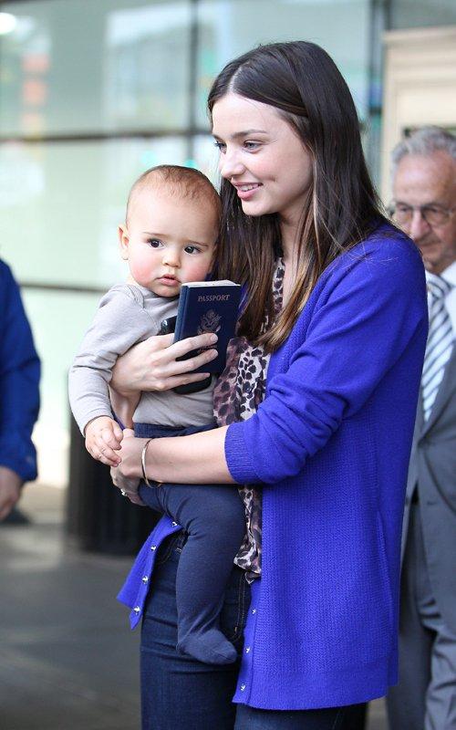 Miranda Kerr and Flynn arrive at JFK Airport in New York City on Sunday (October 16).