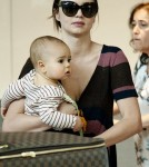 Miranda Kerr and Flynn touched down at Heathrow airport in London (October 5).