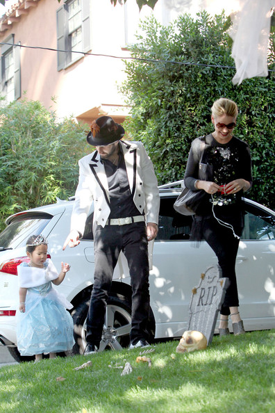 Katherine Heigl wears a witch costume as she and her husband Josh Kelley dress their adorable daughter Naleigh in a princess costume for a Halloween party.