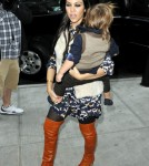 Kourtney Kardashian Carries Around Mason